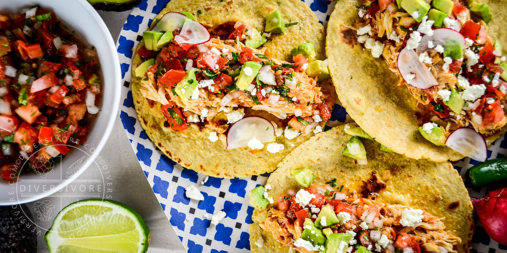Chicken tinga, served as tacos with pico de gallo, avocadoes and cheese - Diversivore.com