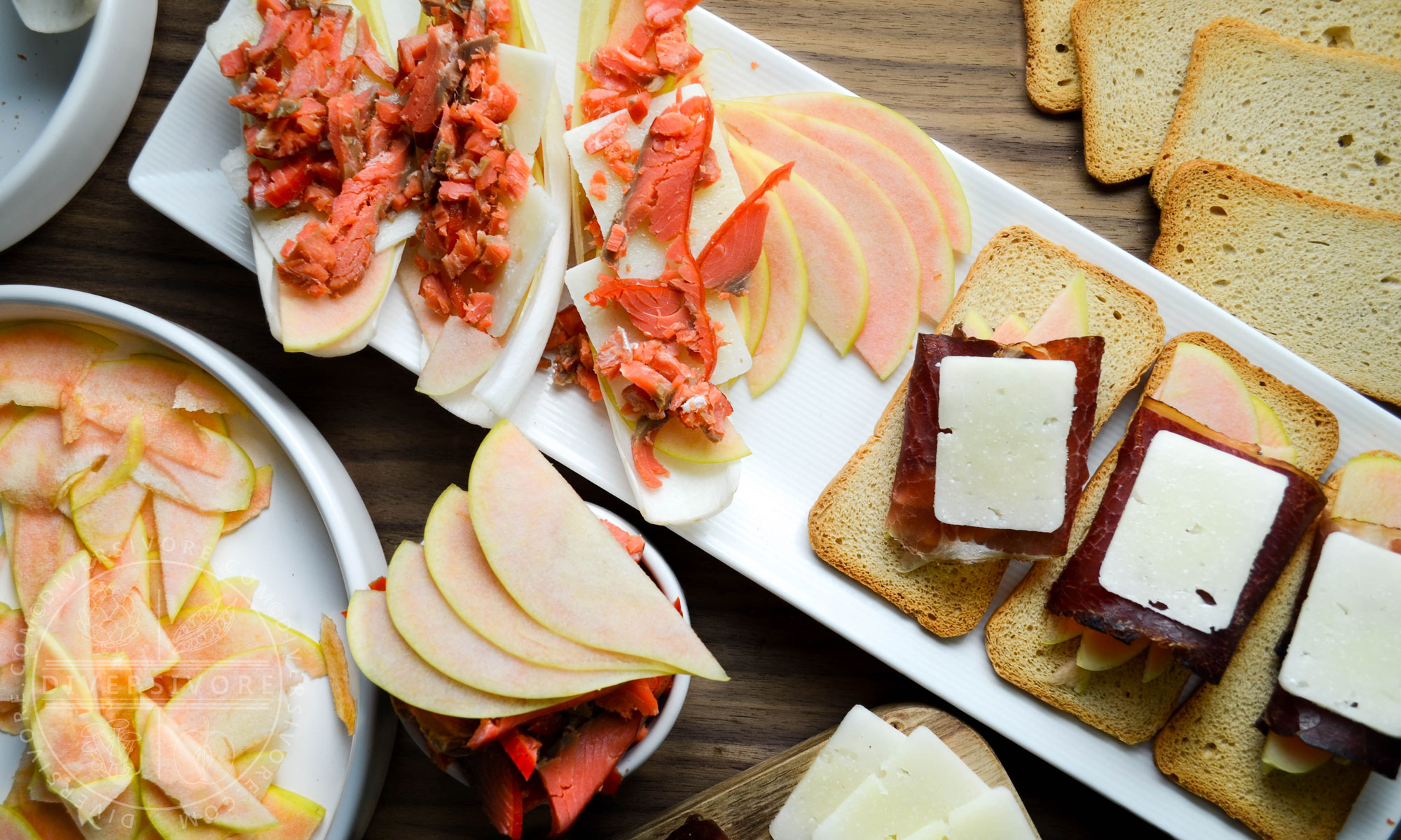 Pink Pearl apples and a charcuterie board with manchego, bison bresaola, smoked salmon, and endive - Diversivore.com
