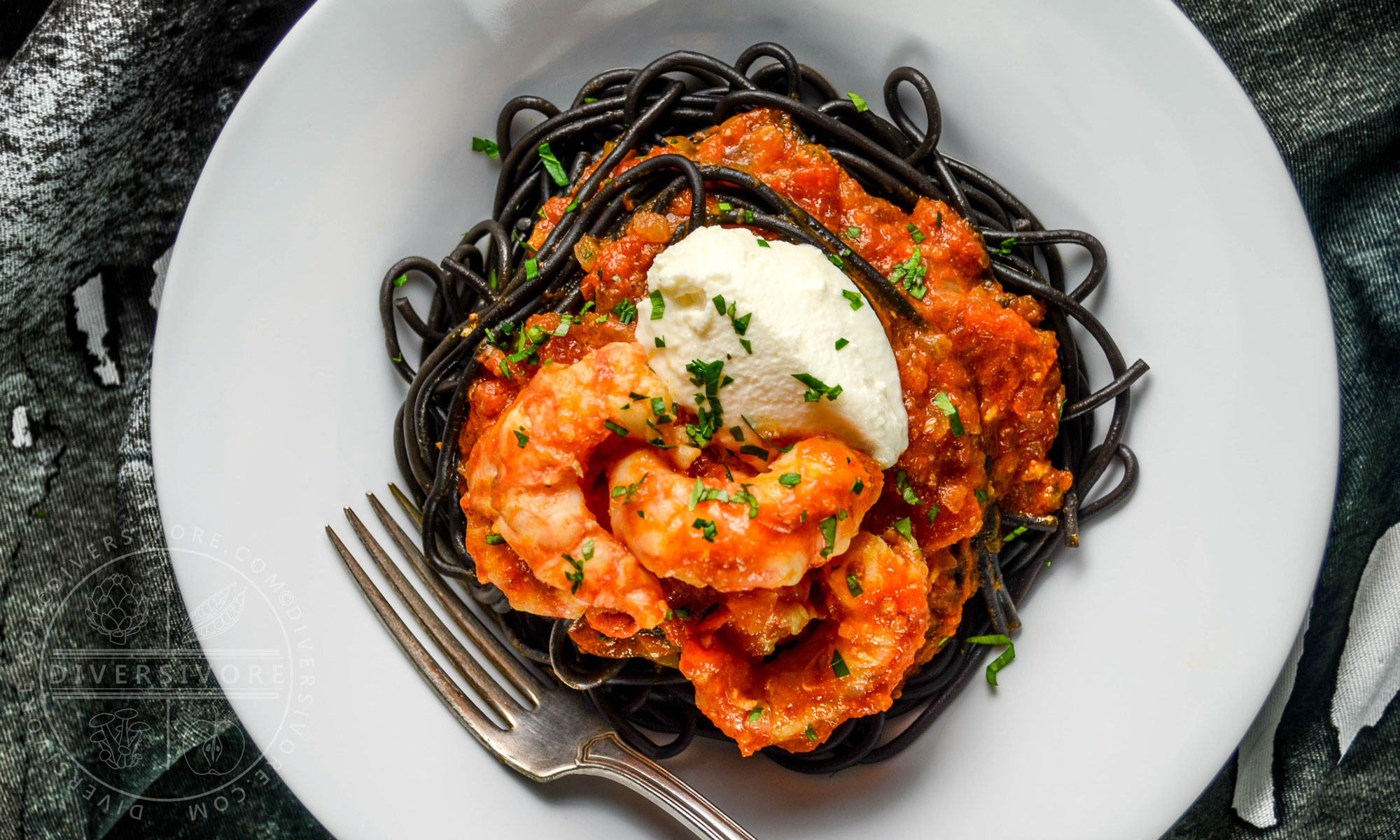 Spot Prawns in a spicy tomato sauce with mascarpone and nero di seppia (cuttlefish ink) pasta - Diversivore.com