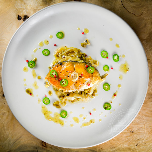 Halibut escabeche - cooked and marinated with olive oil, vinegar, garlic and jalapenos - Diversivore.com