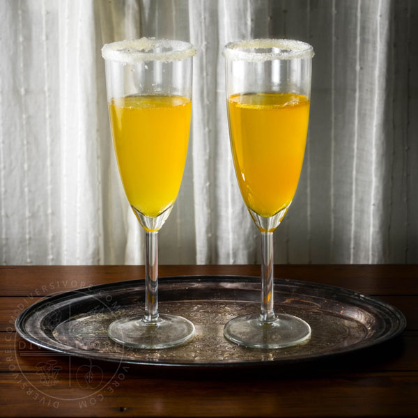Two sparkling saffron cocktails on a tray