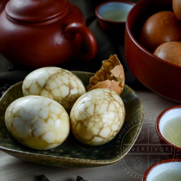 Peeled Taiwanese tea eggs on a ceramic dish