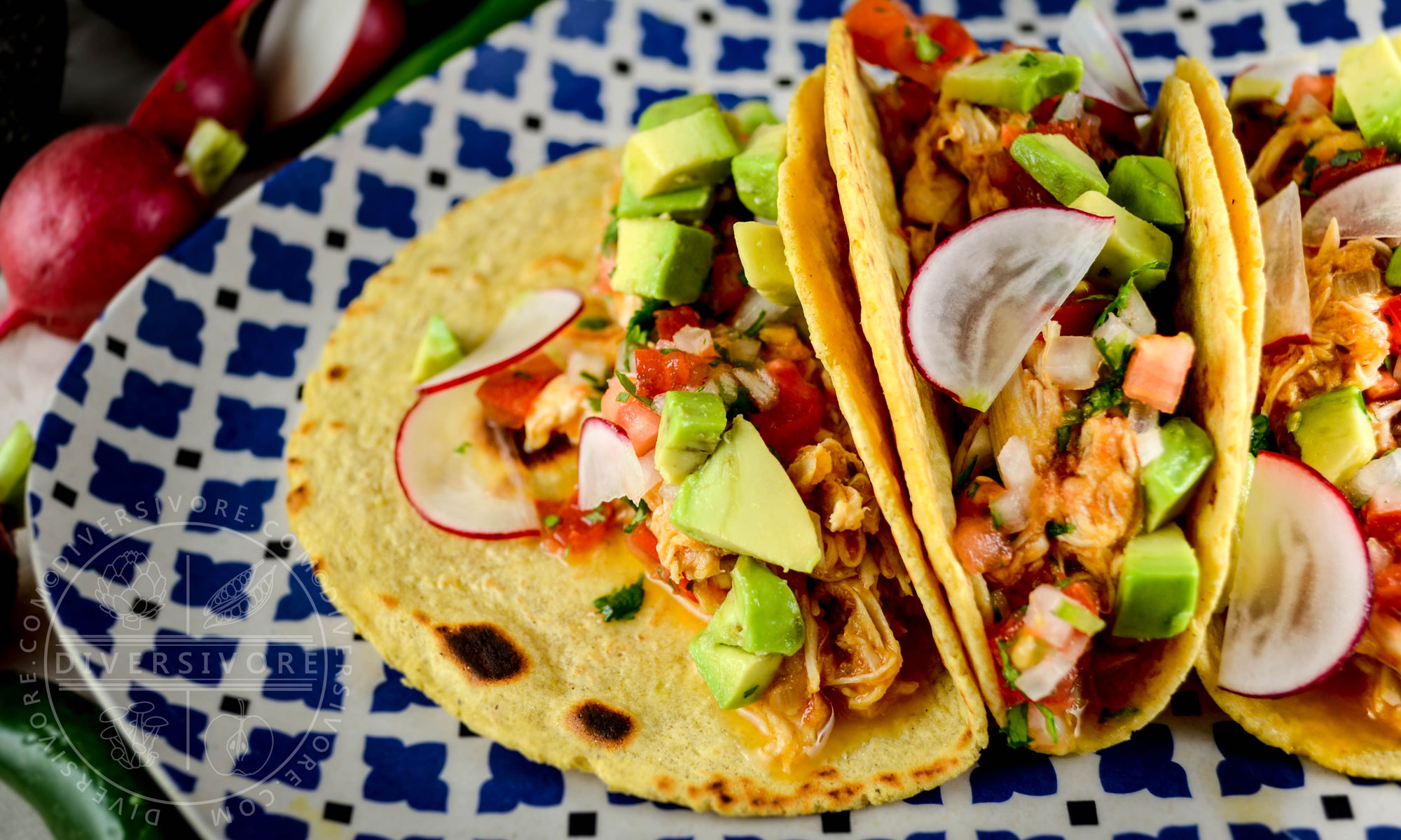 Chicken tinga, served as tacos with pico de gallo, avocados and cheese - Diversivore.com