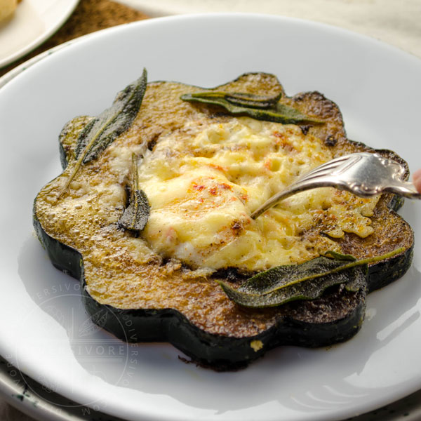 Egg in the Acorn (Toad in the Hole made with acorn squash, cheese, and fried sage)