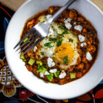 Shakshouka Rancheros - Eggs poached in a spiced tomato sauce, loaded with Mexican flavours and ingredients. - Diversivore.com