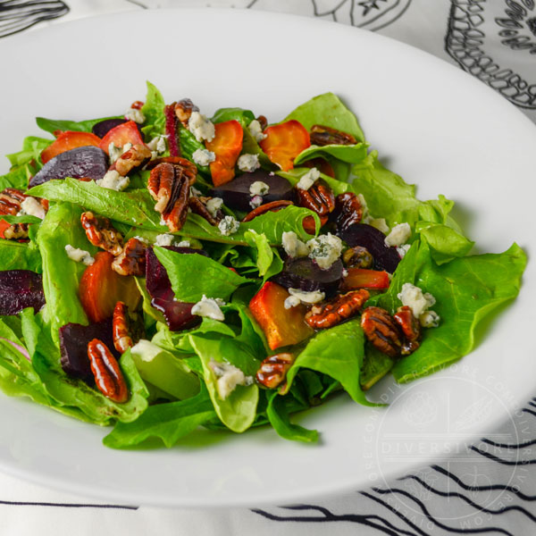 Dandelion and butterleaf lettuce salad with roasted beets, blue cheese, and maple-candied pecans - Diversivore.com