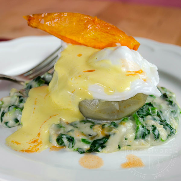 Eggs Sardou - Poached egg served on an artichoke bottom over a bed of creamed spinach and artichoke, served with Hollandaise sauce and a fried tomato skin - Diversivore.com