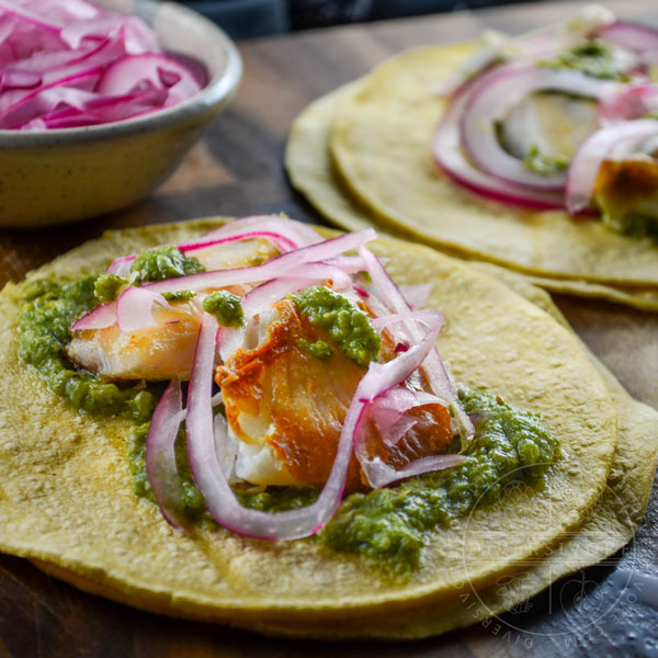 Fish tacos with cilantro corn salsa and pickled red onions