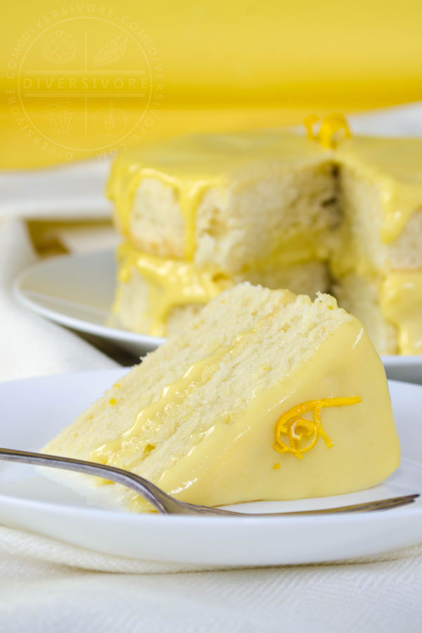 A slice of Lemon Whip Cake with Dairy-Free Lemon Curd served on a white plate