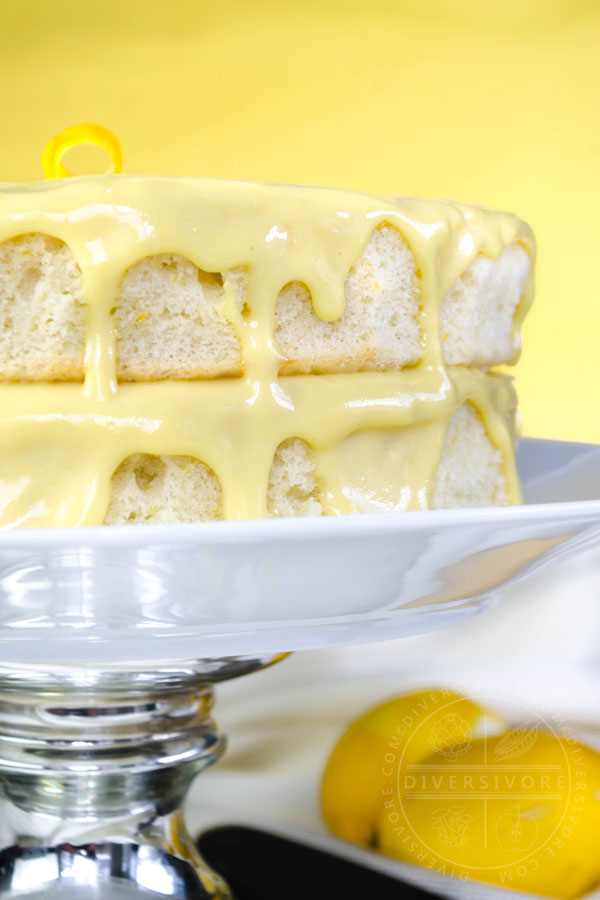 Lemon Whip Cake with Dairy-Free Lemon Curd on a white cake plate with a metal stand